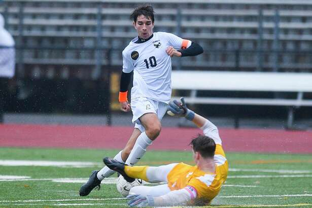 Trumbull's Tiago Frazao (10) plays the ball around Greenwich goalkeeper Padraig Colligan (1) as he attempts to make a save in the first half of a FCIAC league soccer match at Cardinal Stadium in Greenwich, Tuesday, Oct. 22, 2019.