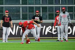 Washington left fielder Juan Soto (22) fields a ball during batting practice before Game 1 of the World Series between the Nationals and the Astros at Minute Maid Park in Houston on Tuesday night.