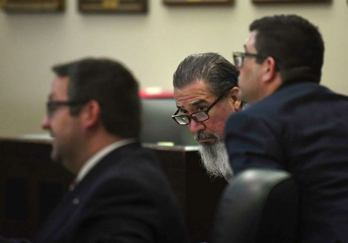 Ricky Cantu, middle, sits with his attorneys, Robert Gebbia, left, and Daniel De La Garza, in 175th District Court on Tuesday, Oct. 22, 2019, where he is on trial for the murder of Rudy Borrego, a motorcyclist who was killed in a traffic accident with Cantu, who was allegedly intoxicated at the time.