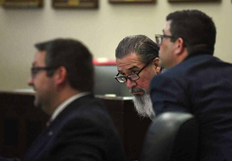Ricky Cantu, middle, sits with his attorneys, Robert Gebbia, left, and Daniel De La Garza, in 175th District Court on Tuesday, Oct. 22, 2019, where he is on trial for the murder of Rudy Borrego, a motorcyclist who was killed in a traffic accident with Cantu, who was allegedly intoxicated at the time. Photo: Billy Calzada /Staff Photographer / San Antonio Express-News