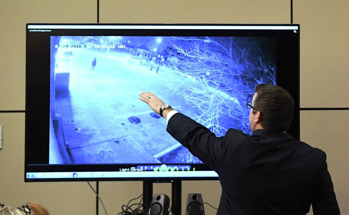 Defense attorney Robert Gebbia watches surveillance video of the traffic crash that took the life of motorcyclist Rudy Borrego in February 2018. Ricky Cantu is on trial for murder. He was allegedly intoxicated when he turned left in front of Borrego.