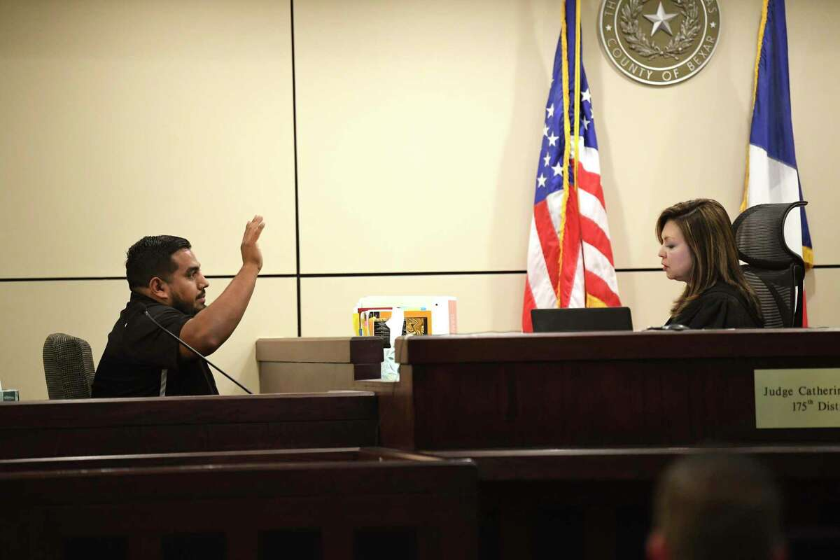 Witness Mario Infante, who was out on a date with his wife when they saw a truck driven by Ricky Cantu crash with a motorcyclist who died, is sworn in by Judge Catherine Torres-Stahl in 175h District Court on Tuesday, Oct. 22, 2019. The driver of the truck, Ricky Cantu, is on trial for murder in the case.