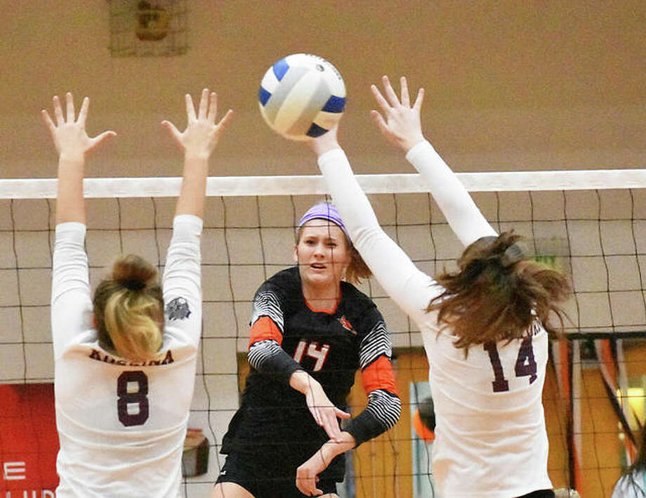 Edwardsville senior Maddie Isringhausen slams one of her six kills through the Belleville West block during the first game Tuesday inside Lucco-Jackson Gymnasium. Photo: Matt Kamp|The Intelligencer