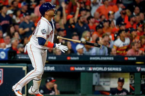 Houston Astros first baseman Yuli Gurriel (10) hits a two-run double during the first inning of Game 1 of the World Series at Minute Maid Park in Houston on Tuesday, Oct. 22, 2019.