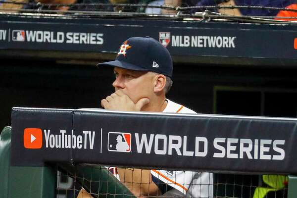 Houston Astros manager AJ Hinch (14) watches from the dugout during the first inning of Game 1 of the World Series at Minute Maid Park in Houston on Tuesday, Oct. 22, 2019.