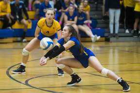 Midland's Edie Haase bumps the ball during a match against Dow Tuesday, Oct. 22, 2019 at Midland High School. (Katy Kildee/kkildee@mdn.net)