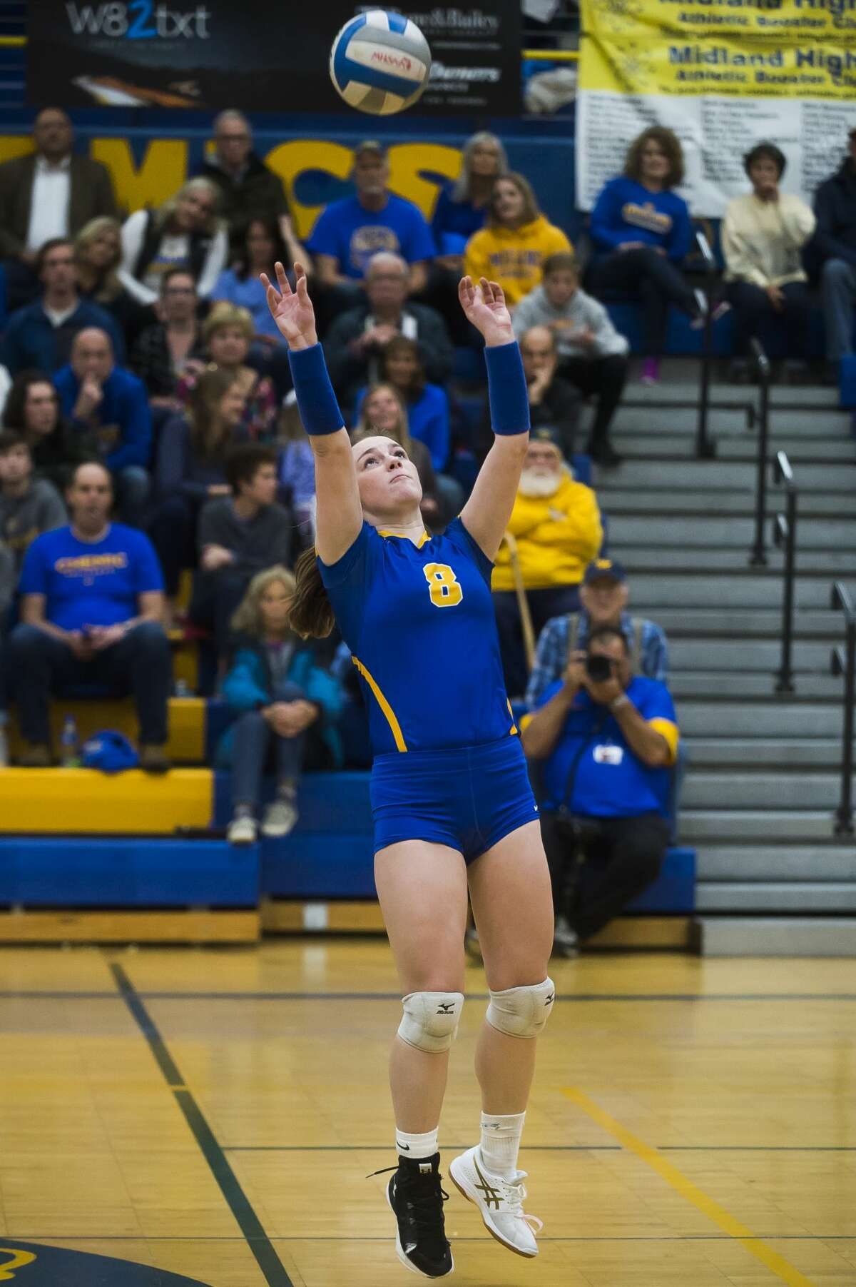 Midland's Olivia DePierro sets the ball during a match against Dow Tuesday, Oct. 22, 2019 at Midland High School. (Katy Kildee/kkildee@mdn.net)