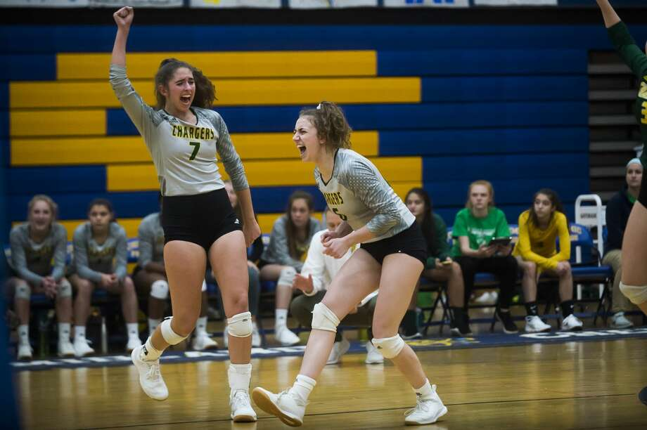 Dow's Hailey Tanis, left, and Francesca Queary, right, celebrate a point during a match against Midland Tuesday, Oct. 22, 2019 at Midland High School. (Katy Kildee/kkildee@mdn.net) Photo: (Katy Kildee/kkildee@mdn.net)