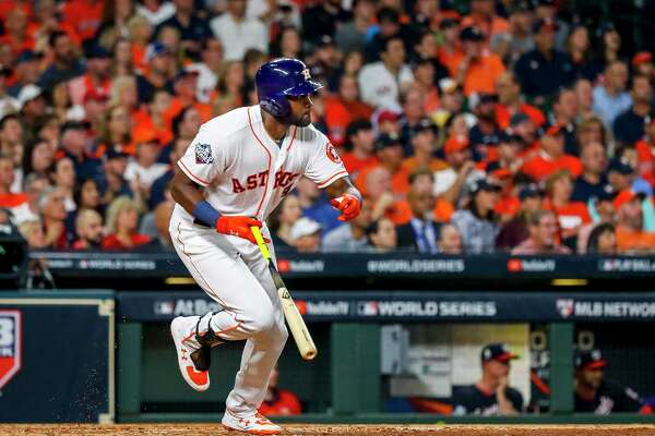 Houston Astros designated hitter Yordan Alvarez (44) hits a single into centerfield during the fourth inning of Game 1 of the World Series at Minute Maid Park in Houston on Tuesday, Oct. 22, 2019.