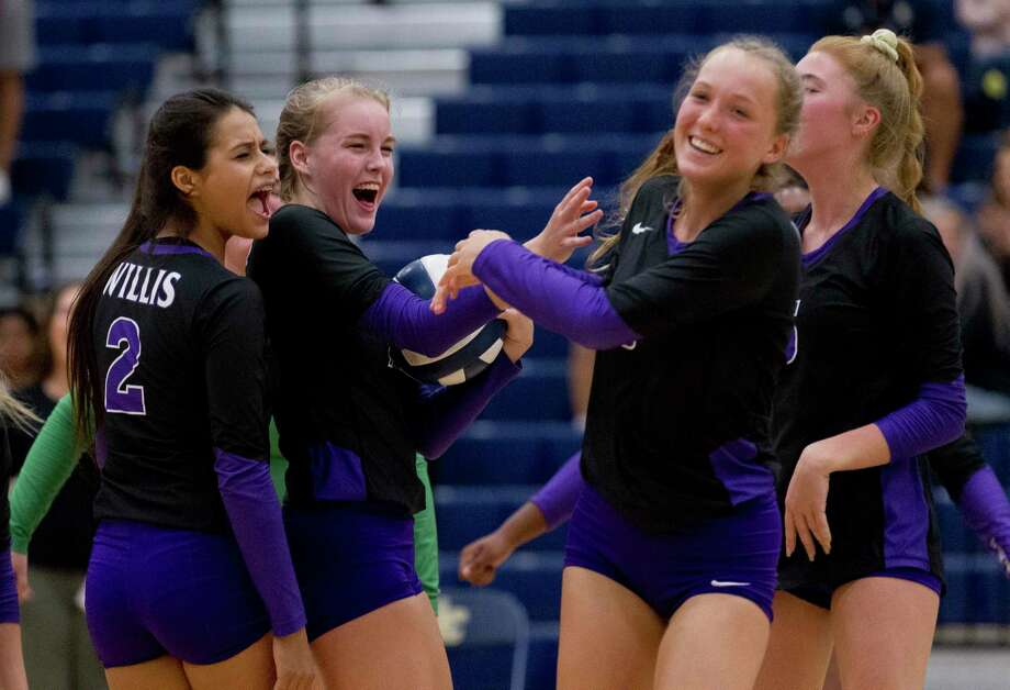 Willis players react after middle hitter Bella Cantara (9) scored the final point to defeat Lake Creek 30-28 during the second set of a District 20-5A high school volleyball match at Lake Creek High School, Tuesday, Oct. 22, 2019, in Montgomery. Photo: Jason Fochtman, Houston Chronicle / Staff Photographer / Houston Chronicle
