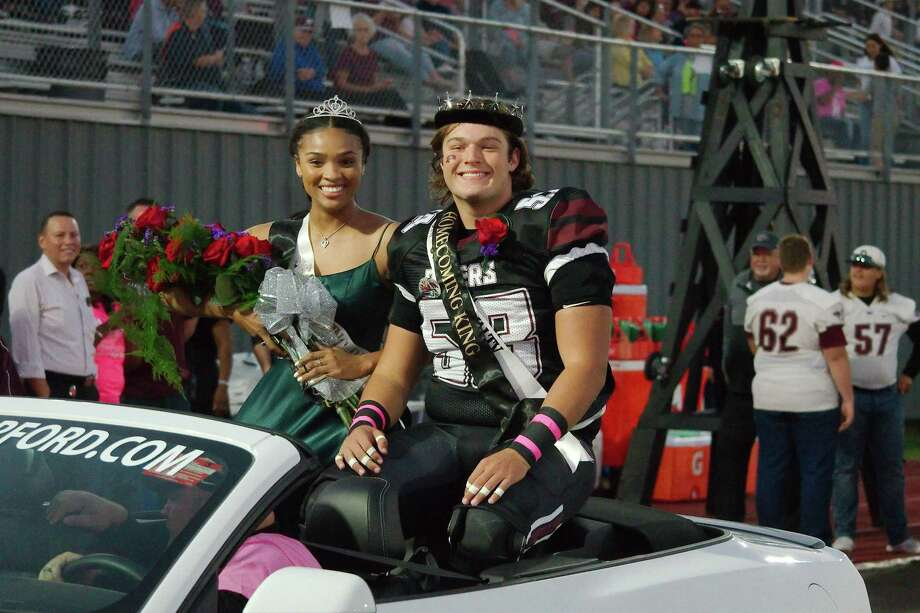April Conant, who was crowned homecoming queen Friday night at Pearland High School, helped lead the Lady Oiler volleyball team to a victory Tuesday night. She is shown with homecoming king Trey Maeker. Photo: Kirk Sides / Staff Photographer / © 2019 Kirk Sides / Houston Chronicle