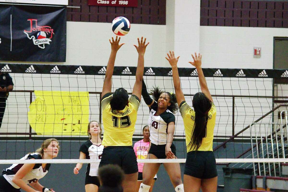Pearland's Jackie Arrington (10) hits a shot past Alief Hastings' Kayla Risper (13) and Nia Bourgeois (9) Tuesday at Pearland High School.