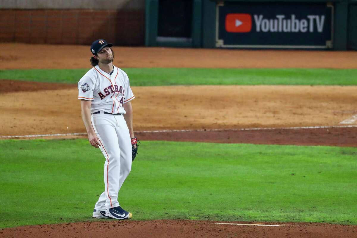 Houston Astros starting pitcher Gerrit Cole (45) reacts after allowing a two-run double by Washington Nationals left fielder Juan Soto (22) during the fifth inning of Game 1 of the World Series at Minute Maid Park in Houston on Tuesday, Oct. 22, 2019.