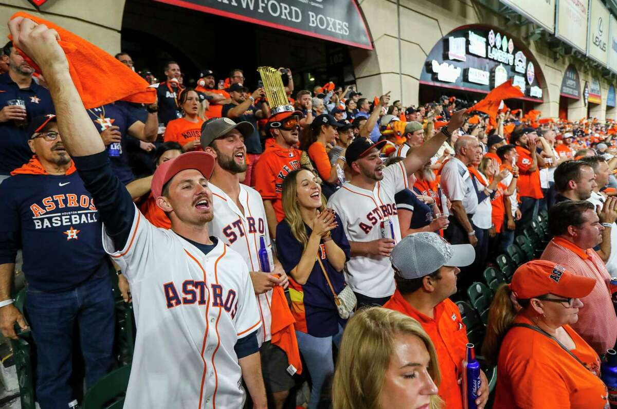 Astros fans watch the fourth inning of Game 1 of the World Series at Minute Maid Park in Houston on Tuesday, Oct. 22, 2019.
