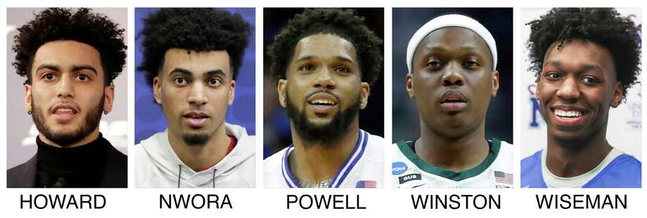 This combo of file photos show, from left, Marquette guard Markus Howard, Louisville junior forward Jordan Nwora, Seton Hall senior guard Myles Powell, Michigan State senior guard Cassius Winston, and Memphis freshman James Wiseman. The five NCAA college basketball players headline The Associated Press 2019-20 preseason All-America team announced Tuesday, Oct. 22, 2019. (AP Photo/File) / AP