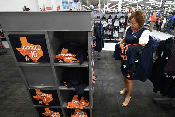 Madeline Singleton shops for Astros attire at Beaumont's Academy on Tuesday. The Astros played the Nationals Monday night in the first game of the 2019 World Series. Photo taken Tuesday, 10/22/19