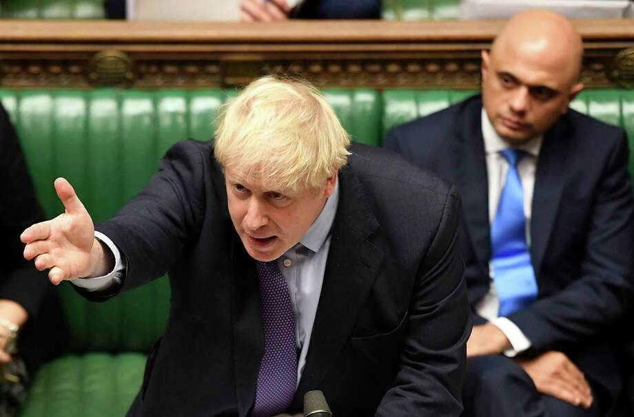 Britain's Prime Minister Boris Johnson gestures as he speaks in the House of Commons in London during the debate for the EU Withdrawal Agreement Bill, Tuesday Oct. 22, 2019. British lawmakers have rejected the governmenta€™s fast-track attempt to pass its Brexit bill within days, demanding more time to scrutinize the complex legislation and throwing Prime Minister Boris Johnsona€™s exit timetable into chaos. (Jessica Taylor, UK Parliament via AP) Photo: Jessica Taylor / UK Parliament