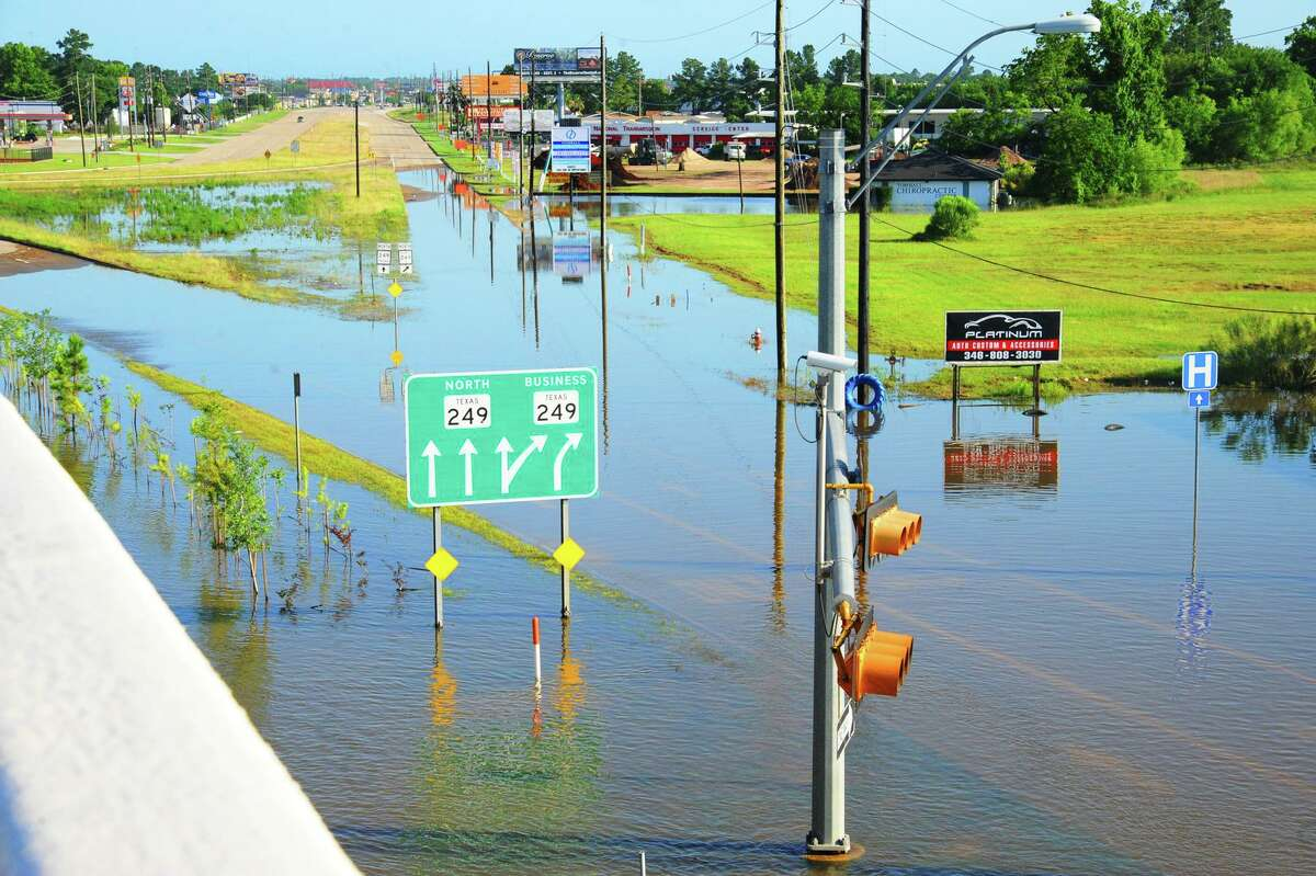The intersection of Business 249 and Holderrieth was flooded on Friday after heavy storms passed through the area Thursday night and Friday. Several roads were closed throughout the Tomball area.