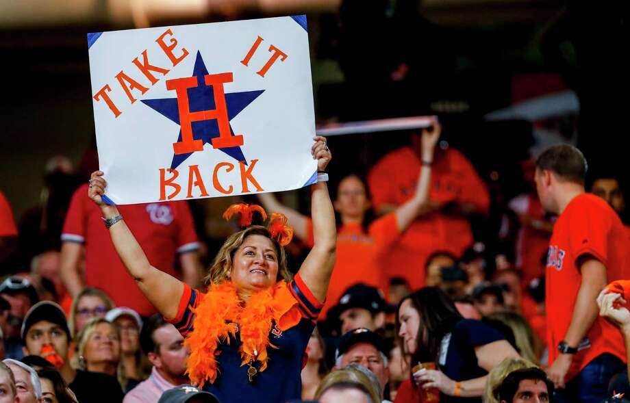 Astros fans cheer during the sixth inning of Game 1 of the World Series at Minute Maid Park in Houston on Tuesday, Oct. 22, 2019. Photo: Brett Coomer, Staff Photographer / © 2019 Houston Chronicle