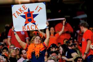 Astros fans cheer during the sixth inning of Game 1 of the World Series at Minute Maid Park in Houston on Tuesday, Oct. 22, 2019.