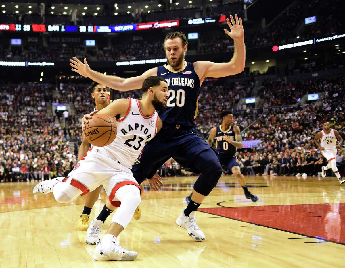 Toronto Raptors guard Fred VanVleet (23) drives around New Orleans Pelicans forward Nicolo Melli (20) during the first half of an NBA basketball game Tuesday, Oct. 22, 2019, in Toronto. (Frank Gunn/The Canadian Press via AP)