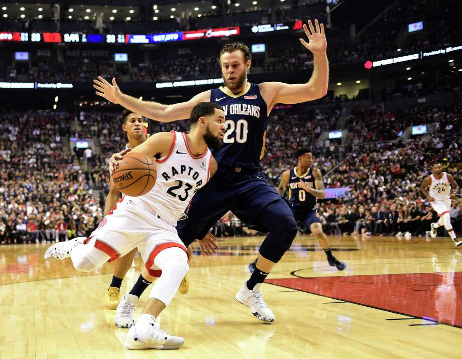 Toronto Raptors guard Fred VanVleet (23) drives around New Orleans Pelicans forward Nicolo Melli (20) during the first half of an NBA basketball game Tuesday, Oct. 22, 2019, in Toronto. (Frank Gunn/The Canadian Press via AP) Photo: Frank Gunn / The Canadian Press