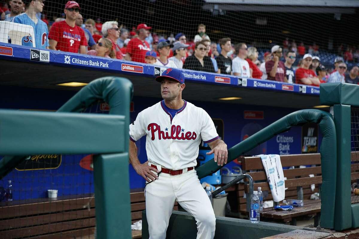Philadelphia Phillies manager Gabe Kapler waits to greet bullpen players after a baseball game against the Miami Marlins, Sunday, Sept. 29, 2019, in Philadelphia. (AP Photo/Matt Slocum)