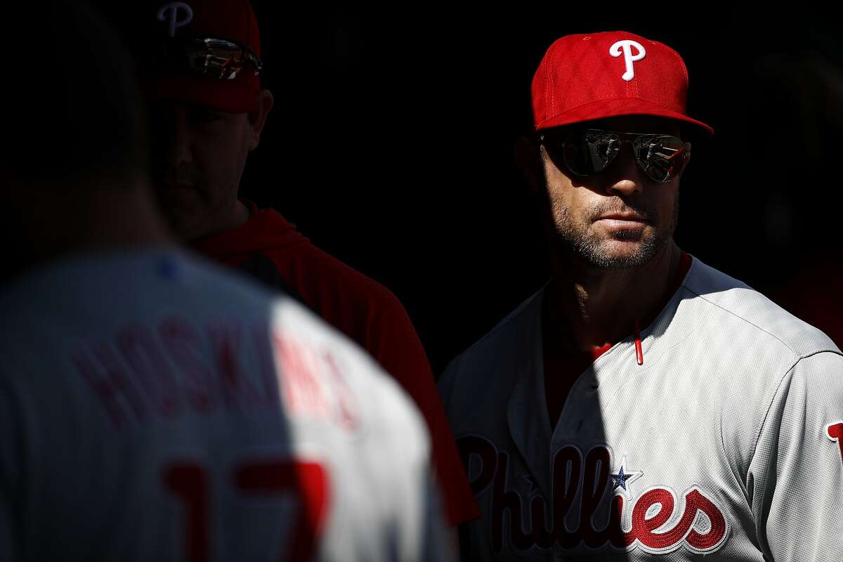 Philadelphia Phillies manager Gabe Kapler walks in the dugout before the first baseball game of a doubleheader against the Washington Nationals, Tuesday, Sept. 24, 2019, in Washington. (AP Photo/Patrick Semansky)