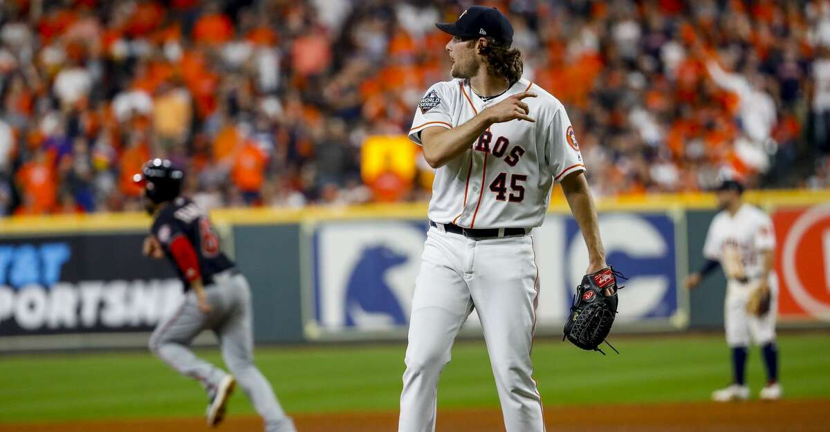 Houston Astros starting pitcher Gerrit Cole (45) watches as Washington Nationals left fielder Juan Soto (22) hits a two-run double during the fifth inning of Game 1 of the World Series at Minute Maid Park in Houston on Tuesday, Oct. 22, 2019.