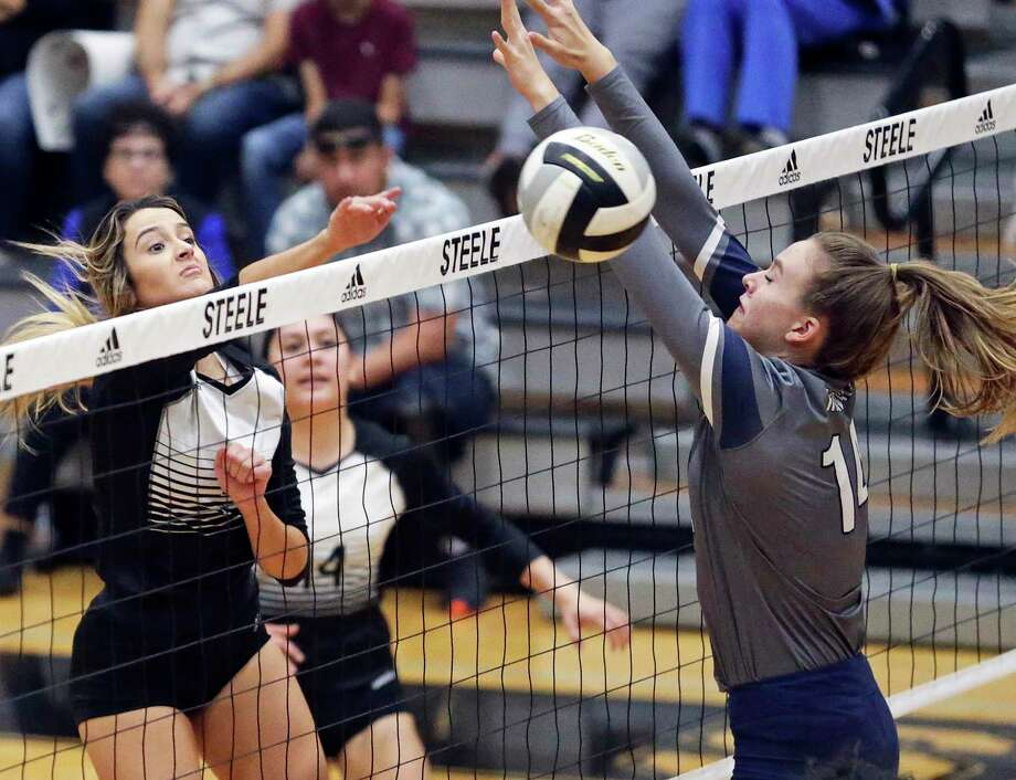 Steele's Veronica Lansford slips one past Smithson Valley's Jada West in the Knights' four-set win. Photo: Tom Reel /Staff Photographer / 2019 SAN ANTONIO EXPRESS-NEWS