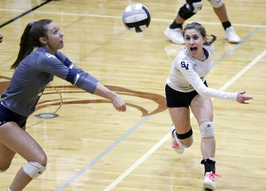 Smithson Valley's Bekah Williams and Ashley Acuna (right) chase after a ball during a District 26-6A volleyball match Tuesday vs. Steele. Photo: Tom Reel / 2019 SAN ANTONIO EXPRESS-NEWS