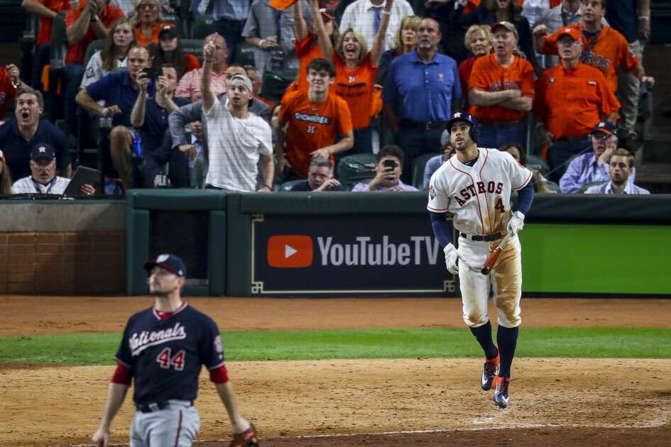 Houston Astros center fielder George Springer (4) hits an RBI double during the eighth inning of Game 1 of the World Series at Minute Maid Park in Houston on Tuesday, Oct. 22, 2019.