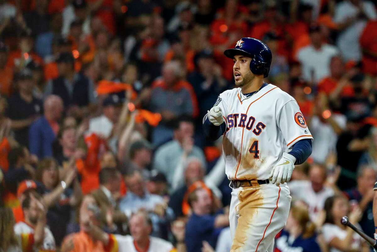 Houston Astros centerfielder George Springer (4) comes home after hitting a solo home run against Washington Nationals relief pitcher Tanner Rainey (21) during the seventh inning of Game 1 of the World Series at Minute Maid Park in Houston on Tuesday, Oct. 22, 2019.