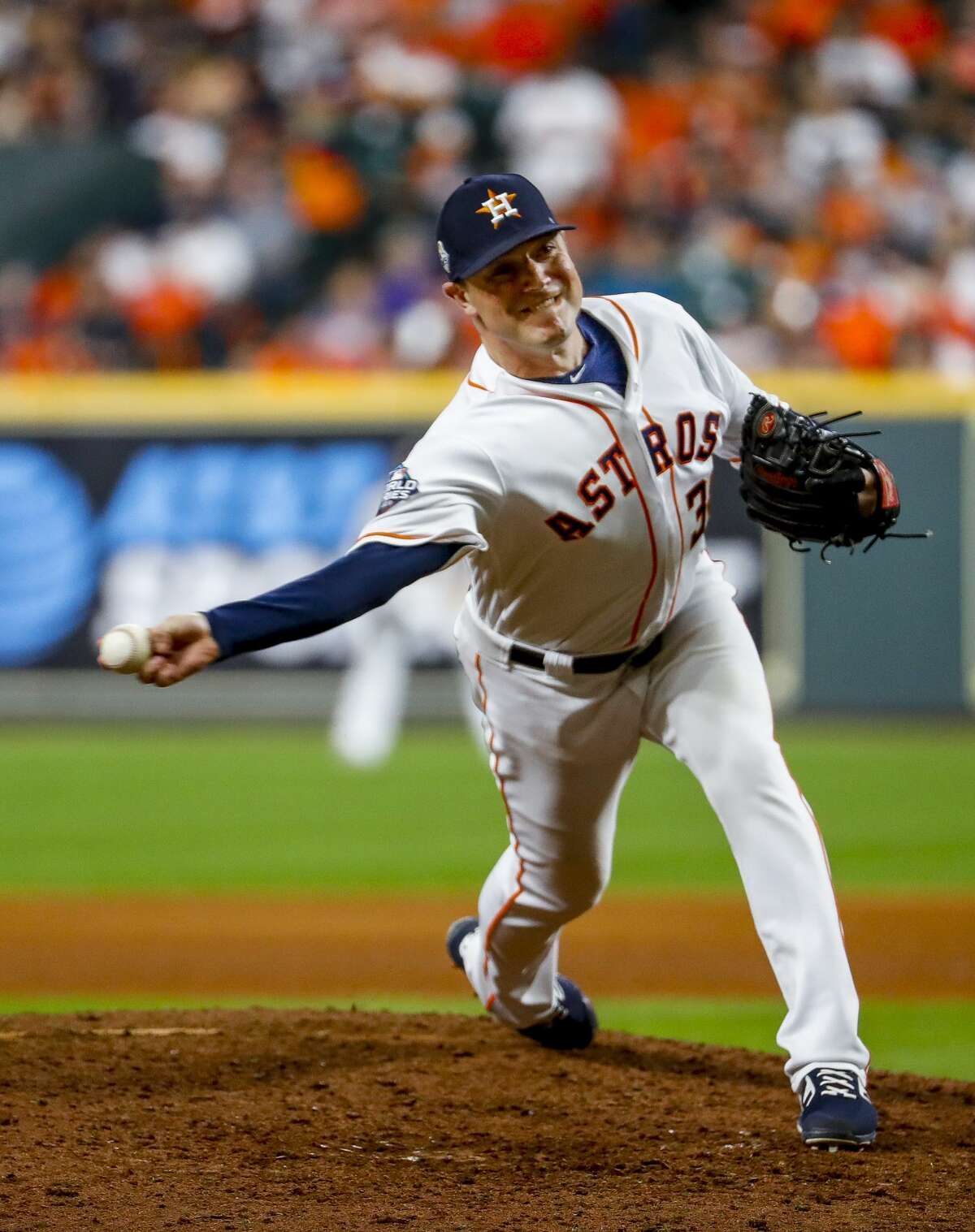 Houston Astros relief pitcher Joe Smith (38) pitches during the ninth inning of Game 1 of the World Series at Minute Maid Park in Houston on Tuesday, Oct. 22, 2019.