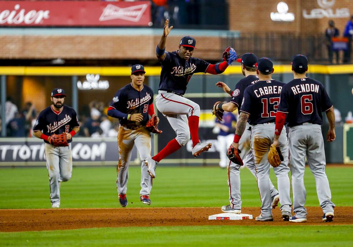 The Washington Nationals celebrate as they win Game 1 of the World Series at Minute Maid Park in Houston on Tuesday, Oct. 22, 2019.