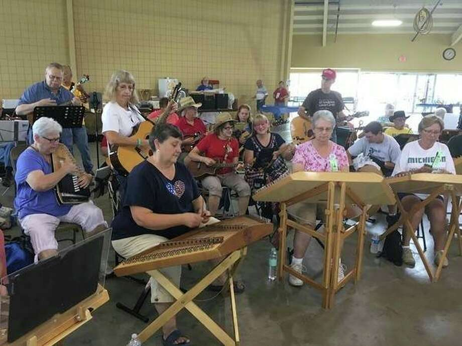 Friday, Oct. 25: Folk Music Society of Midland, seen here at the 2019 music festival, will host an acoustic jam at Mount Haley Township Hall, 3020 S. Homer Road, Midland. (Photo provided/Folk Music Society of Midland)