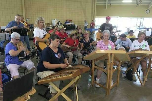 Friday, Oct. 25: Folk Music Society of Midland, seen here atthe2019music festival, will host an acoustic jam at Mount Haley Township Hall, 3020 S. Homer Road, Midland.(Photo provided/Folk Music Society of Midland)