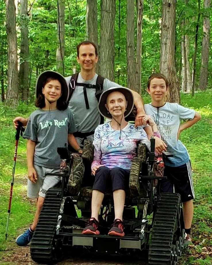 The Track Chair Program, operated by volunteers with Friends of Sleeping Bear Dunes, helps visitors to the park with mobility problems enjoy Bay View Trail. (Courtesy photo)
