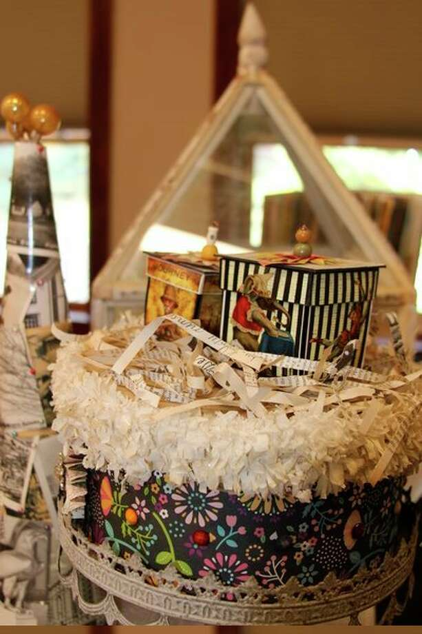 The For the Love of Art and Paper event showcased how old everyday items, like maps, magazines and books, could be turned into art.