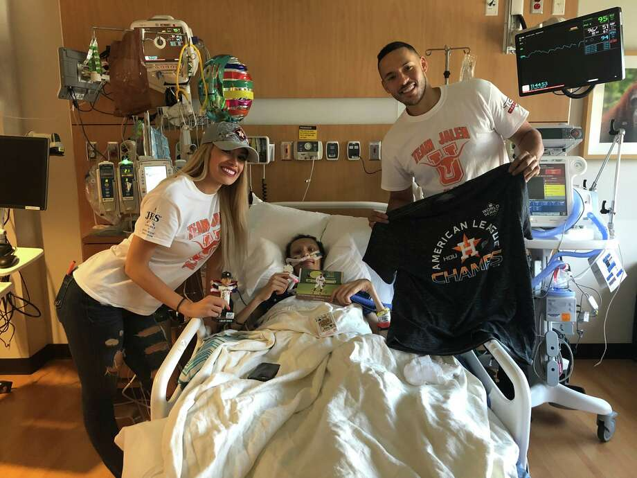 "Astros star shortstop Carlos Correa and his fiancee Daniella Rodriguez visited Laredoan Jalen Garcia on Tuesday at the MD Anderson Cancer Center in Houston prior to the team's World Series opening game that night against the Nationals. The pair wore ""Team Jalen"" shirts as they continue to help the United High School student in his battle with metastatic osteosarcoma.   Photo: Courtesy"