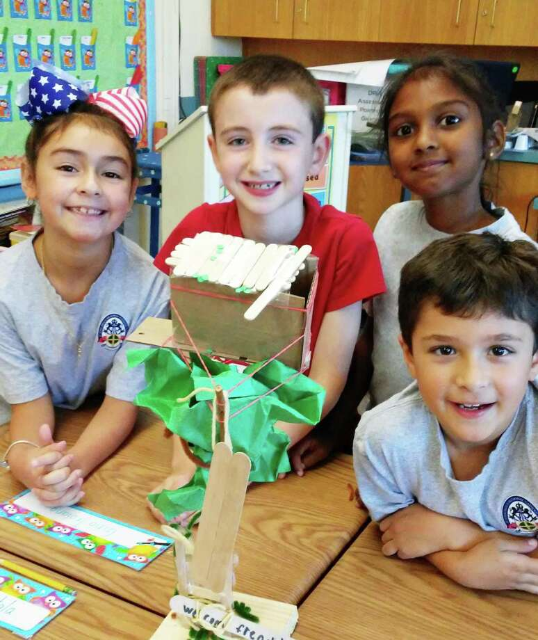 St. John Paul II Catholic School is entering its second year of its STREAM initiative. This year, the first Friday of the month is set aside for activities centered around the project at the Middletown school. Ulli Dzimian's third-grade class finished reading a book from the Magic Tree House series and students were challenged to create their own tree house. Her husband built the tree base, and each group of students had to collaborate on the design and development of their tree house using the engineering design process. Photo: Contributed Photo
