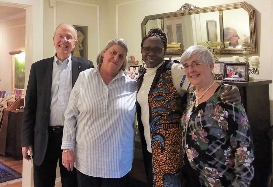 From l to r, J. Philip Smith; Orange Rotarian Lynda A. Hammond; Nambale Magnet School founder Evalyn Wakhusama; and Loretta Smith, during a gathering at the Smith's home in Orange. Both of the Smith are involved in WIKS-USA, a non profit that supports the school, and Hammond was instrumental in securing a recent Rotary grant the school received. Photo: Helen Bennett / Hearst Connecticut Media