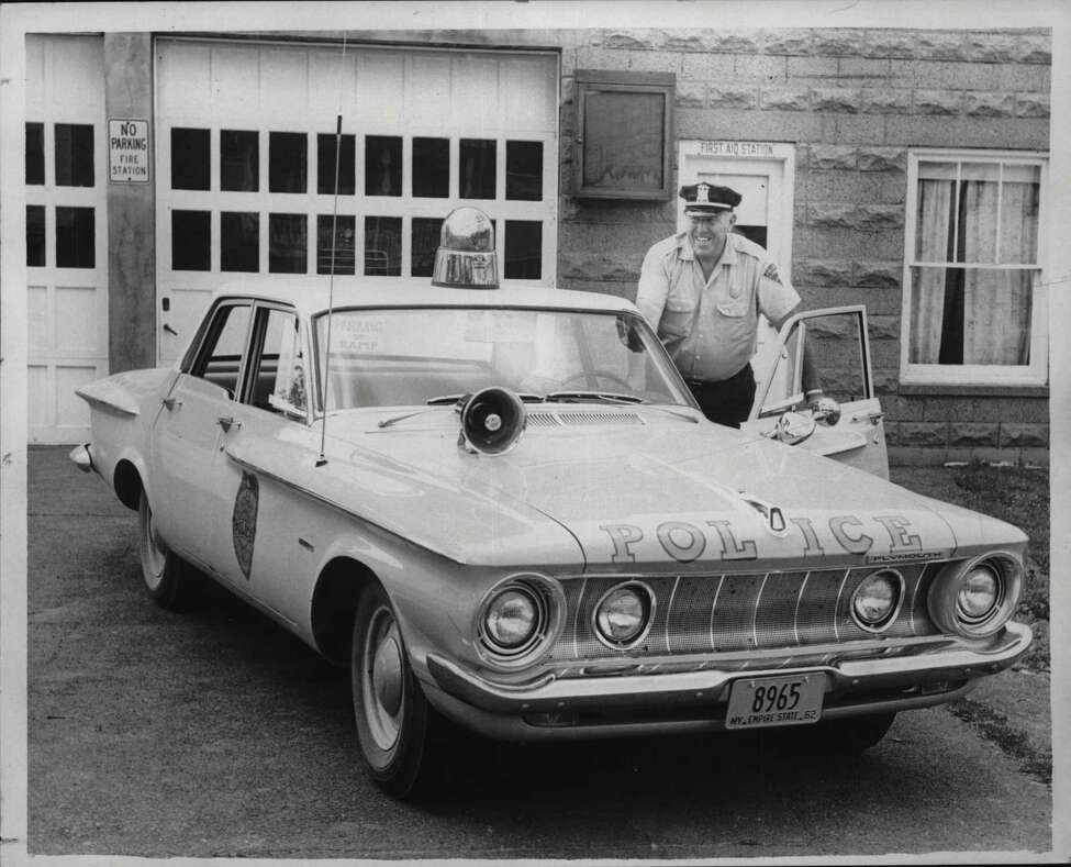 Altamont, New York Police Chief Howard Diehl with squad car. July 06, 1962 (Times Union Archive)