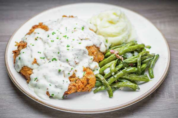 Chicken fried ribeye steak with mashed potatoes and green beans at Killen's Barbecue