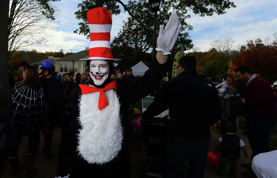 Michael Crystal volunteers to lead The Wilton Chamber of Commerce annual trick-or-treating and pumpkin parade in Wilton Center Saturday, October 29, 2016, in Wilton, Conn.. Photo: Erik Trautmann / Hearst Connecticut Media / Norwalk Hour