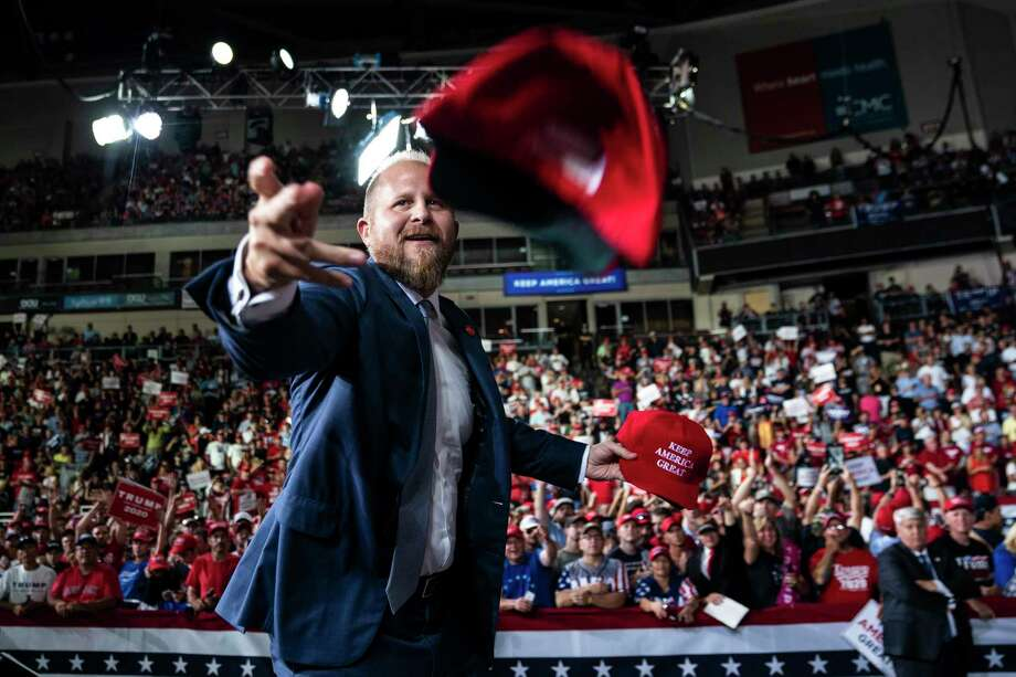 Brad Parscale, President Trump's 2020 campaign manager, throws out hats before a rally in Manchester, N.H., on Aug 15. Photo: Washington Post Photo By Jabin Botsford / The Washington Post
