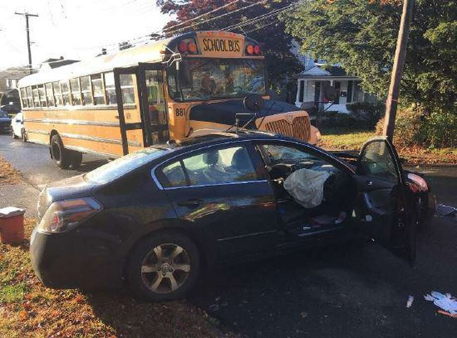 A Hamden school bus and a car collided near the intersection of Lakeview Avenue and Benham Street Wednesday morning. Photo: Hamden Fire Department