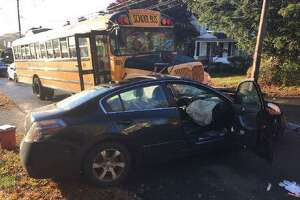 A Hamden school bus and a car collided near the intersection of Lakeview Avenue and Benham Street Wednesday morning.