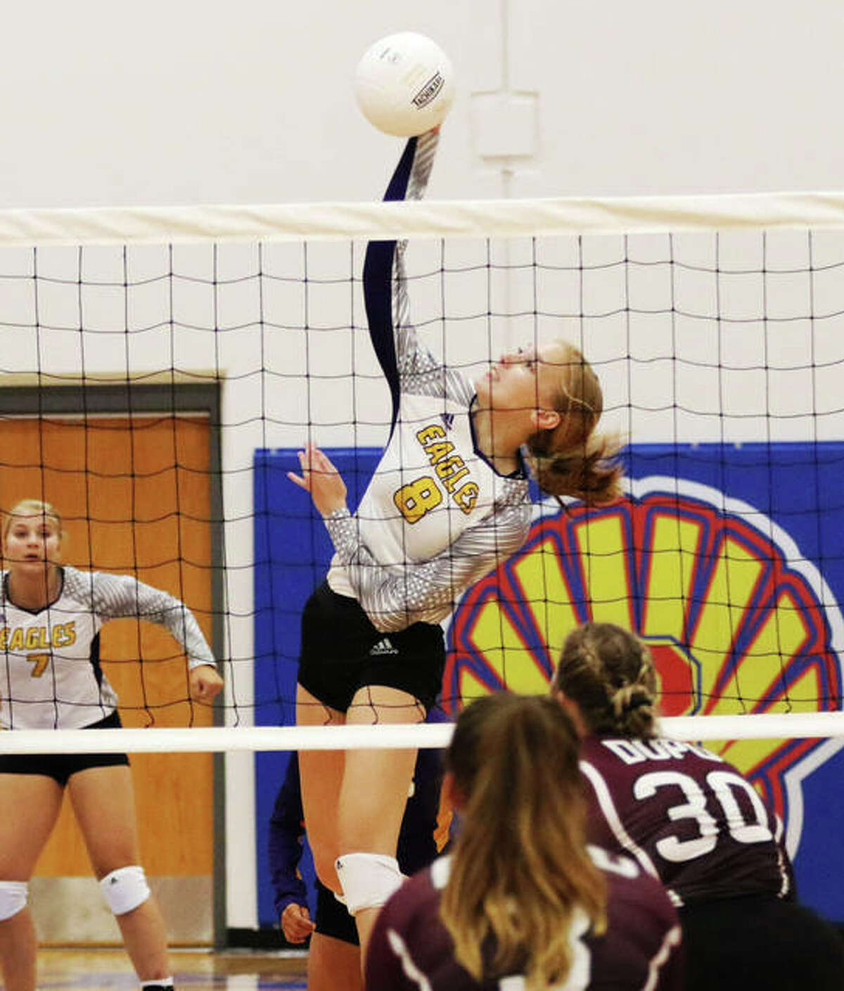 CM's Sydney Henke attacks from the middle during an Eagles' win over Dupo on Aug. 26 in the Roxana Tourney at Roxana Junior High. On Tuesday in Bethalto, Henke had six kills in the Eagles' MVC loss to Mascoutah.