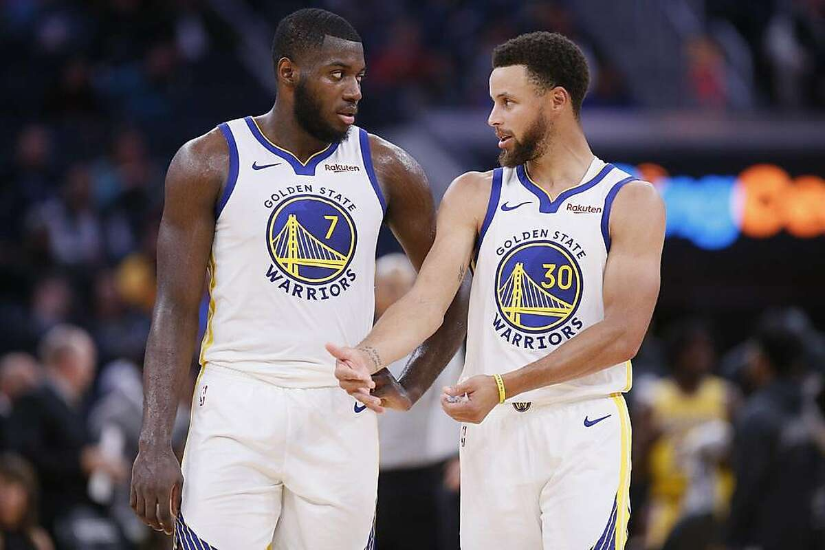 Golden State Warriors forward Eric Paschall (7) and guard Stephen Curry (30) in the fourth quarter of an NBA preseason game against the Los Angeles Lakers at Chase Center on Friday, Oct. 18, 2019, in San Francisco, Calif.